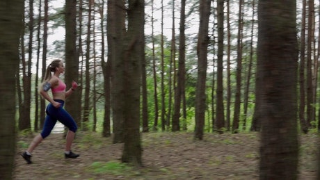 Woman running through the forest