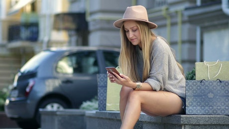 Woman shopping on her phone