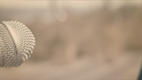 Woman singing into a microphone closeup