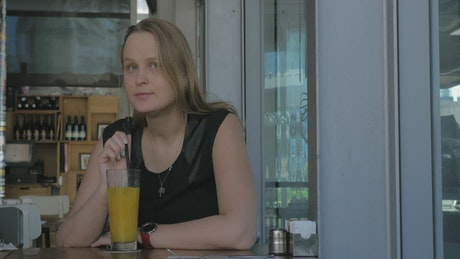 Woman sitting alone in a cafe