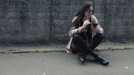 Woman sitting with her phone