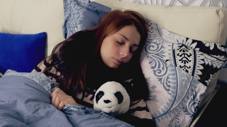 Woman sleeping with a toy Panda