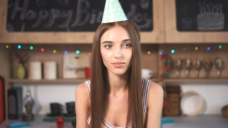 Woman smiles at surprise birthday party with friends