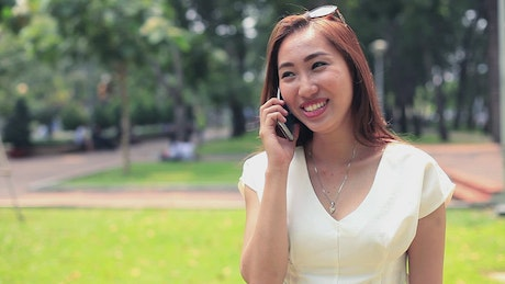 Woman smiles on a call on her cell phone