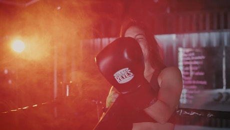 Woman smiling after boxing class