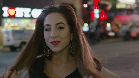 Woman smiling in Times Square