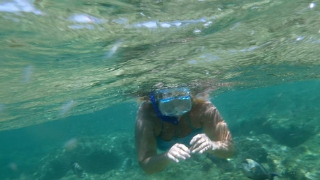 Woman swimming over a reef