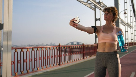 Woman taking a selfie during a workout