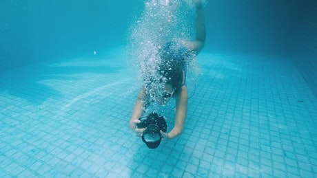 Woman taking underwater pictures