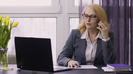 Woman talking on her cell while working