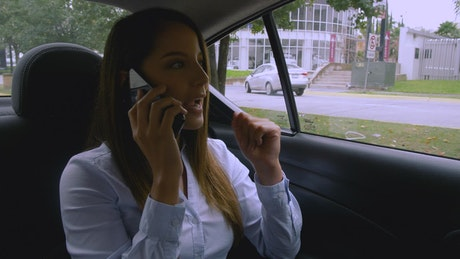 Woman talking on the phone in a car