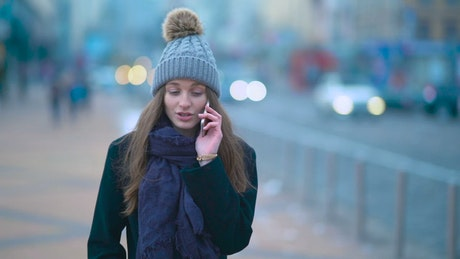 Woman talking on the phone in the street