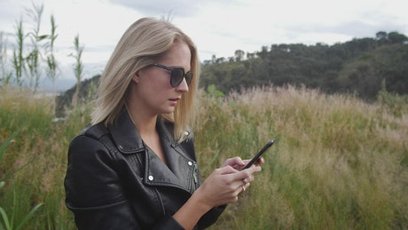 Woman texting in nature
