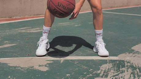 Woman training for basketball