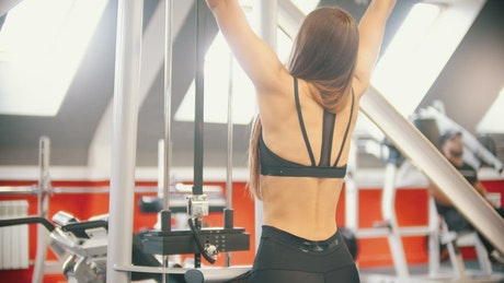 Woman training with weights at the gym