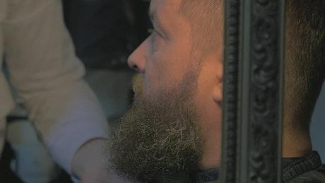Woman trimming a long beard