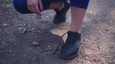 Woman tying her shoes