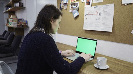 Woman typing quickly on a laptop