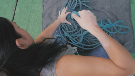 Woman untangling the rope from a harness