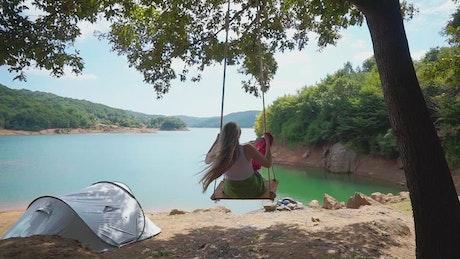 Woman using a lake swing