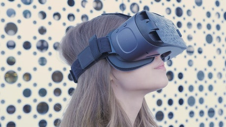 Woman using a VR headset in a bright room
