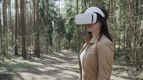 Woman using a VR headset outside