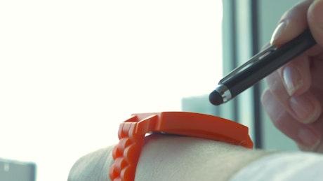Woman using her digital watch