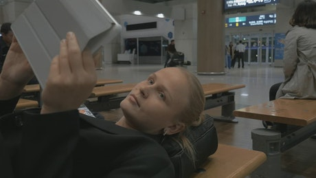 Woman waiting during a flight delay