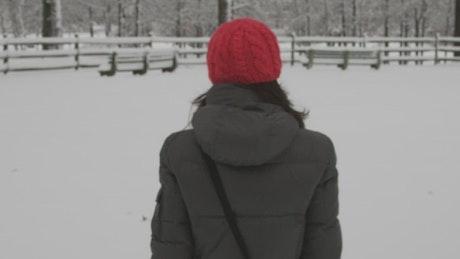 Woman walking slowly through snow
