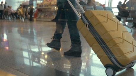 Woman walking slowly towards a terminal