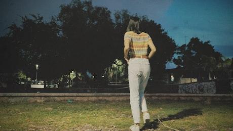 Woman walking through a skate park