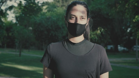 Woman walking with mask on outdoors