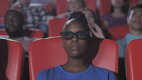 Woman watching a film in a movie threater