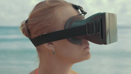 Woman watching a VR video outside