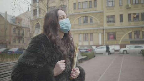 Woman wearing a face mask on the street
