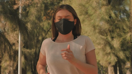 Woman wearing a face mask while jogging