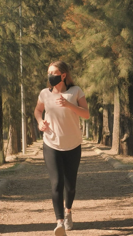 Woman wearing a mask while running