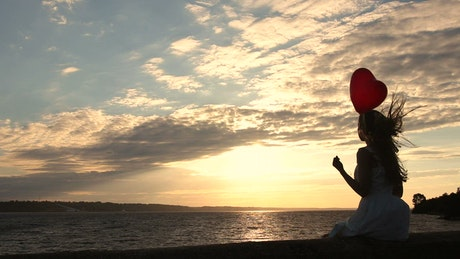 Woman with a heart balloon