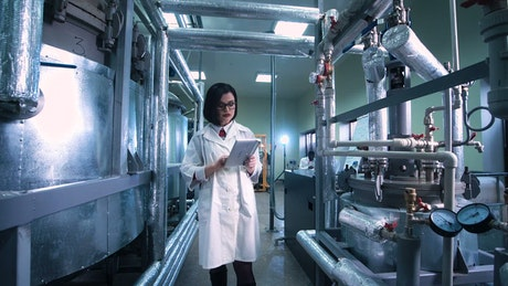 Woman with a tablet in the laboratory