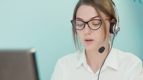 Woman with glasses doing customer support