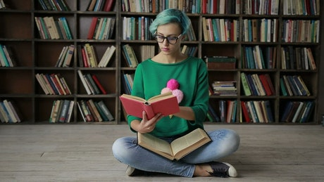 Woman with glasses reading in the library