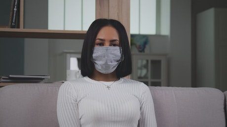 Woman with medical face mask looking to camera