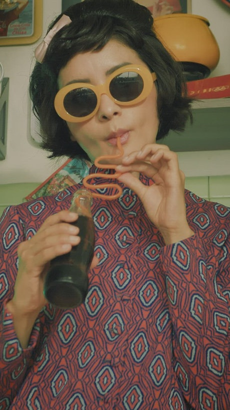 Woman with old fashion style drinking coke