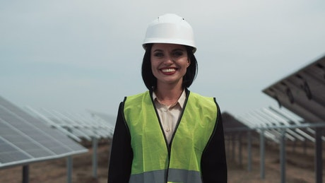 Woman with security helmet smiling outdoors