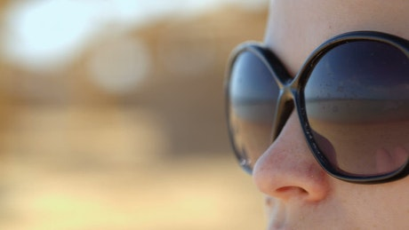 Woman with wide sunglasses