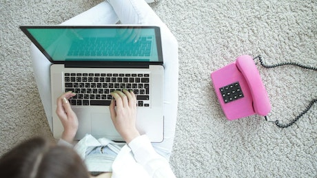 Woman working from home on her laptop, top shot