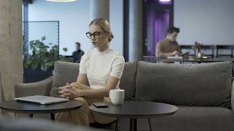 Woman working with a laptop in the office