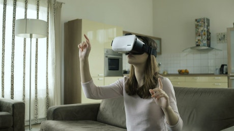 Woman working with virtual reality at home