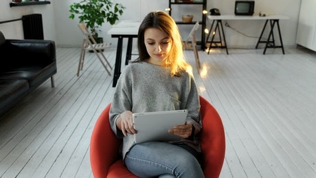 Woman works from her tablet at home