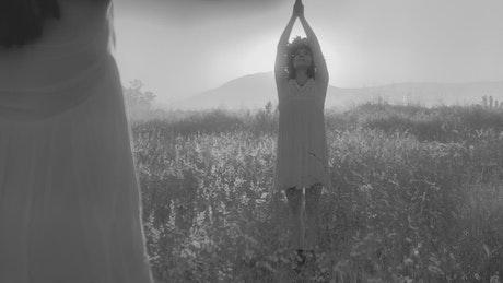 Women doing a ritual in the countryside